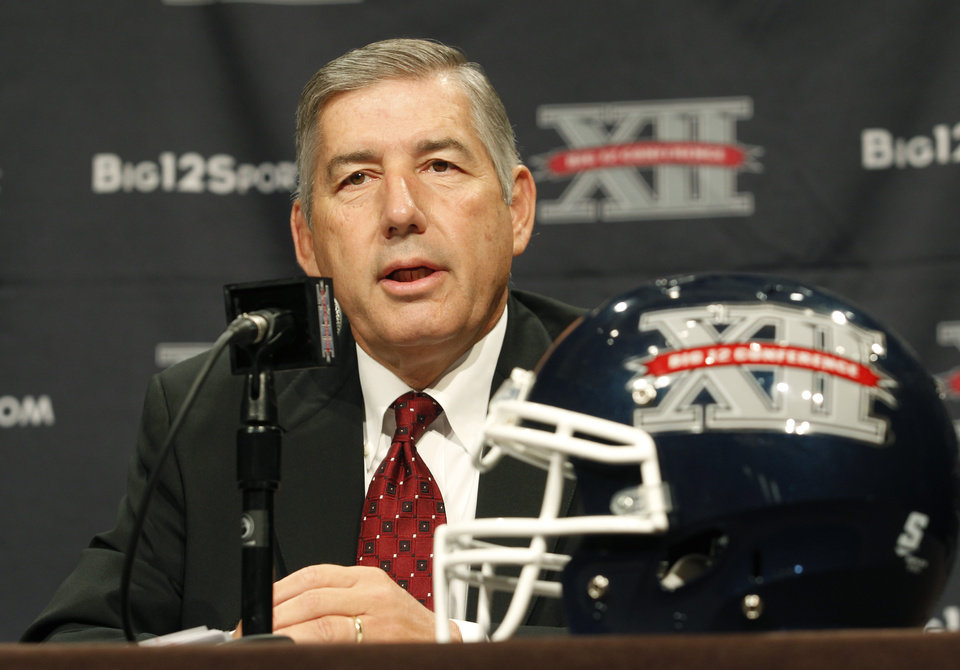 Big 12 Conference Commissioner Bob Bowlsby addresses the media at the beginning of the Big 12 Conference Football Media Days,  Monday, July 22, 2013 in Dallas.  (AP Photo/Tim Sharp) ORG XMIT: TXTS101