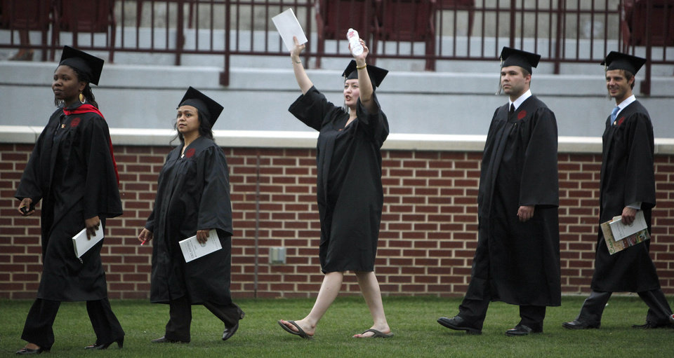 Photo - Hester Anne Brown of Oklahoma City cheers as she walks during the 2009 University of Oklahoma Commencement at the Gaylord Family Oklahoma -Memorial Stadium, Friday, May 15, 2009, in Norman, Okla. Photo by Sarah Phipps, The Oklahoman