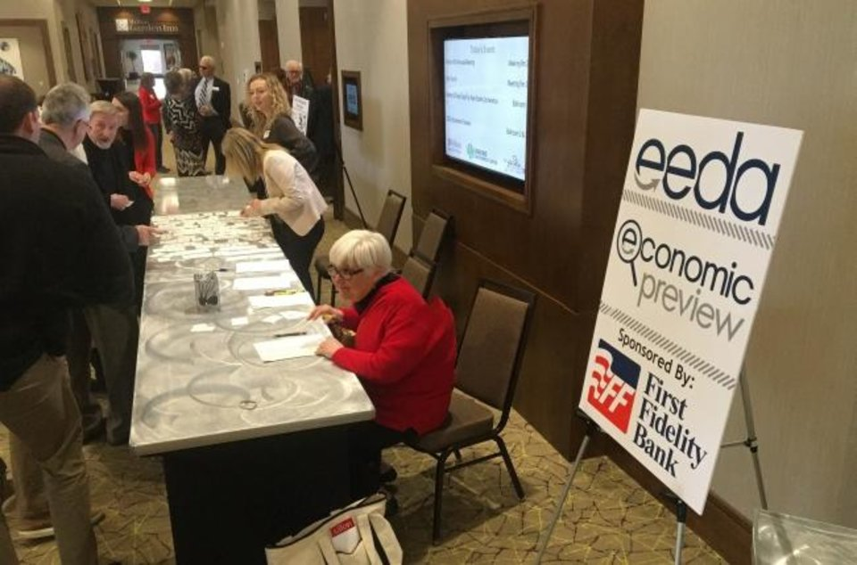 Photo -  People register for the annual Edmond Economic Preview, presented by the Edmond Economic Development Authority and sponsored by First Fidelity Bank, on Thursday at the Edmond Conference Center. [RICHARD MIZE/THE OKLAHOMAN]