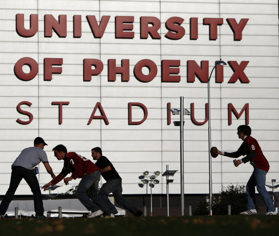 OU fans play football outside the stadium before the Fiesta Bowl college football game between the University of Oklahoma Sooners and the University of Connecticut Huskies in Glendale, Ariz., at the University of Phoenix Stadium on Saturday, Jan. 1, 2011.  Photo by Bryan Terry, The Oklahoman