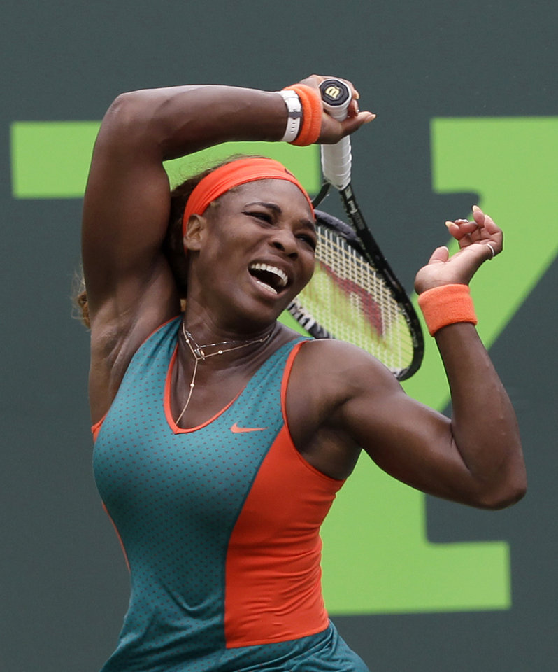 Photo - Serena Williams, of the United States, returns to Caroline Garcia, of France, at the Sony Open tennis tournament in Key Biscayne, Fla., Saturday, March 22, 2014. (AP Photo/Alan Diaz)