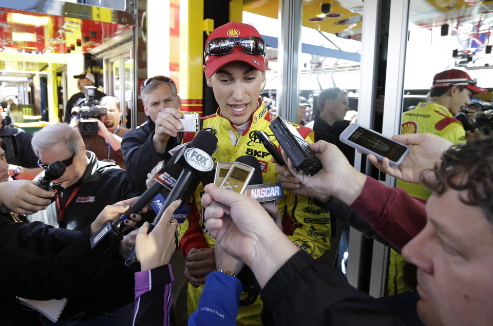 Photo - Driver Joey Logano speaks with the media after practice for Sunday's NASCAR Sprint Cup Series auto race at Martinsville Speedway in Martinsville, Va., Friday, April 5, 2013.  (AP Photo/Steve Helber)