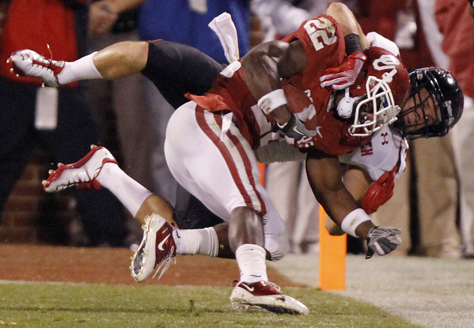 Photo - Texas Tech's Brett Dewhurst (30) stops Oklahoma's Roy Finch (22) near the goal line during the college football game between the University of Oklahoma Sooners (OU) and Texas Tech University Red Raiders (TTU) at the Gaylord Family-Oklahoma Memorial Stadium on Saturday, Oct. 22, 2011. in Norman, Okla. Photo by Chris Landsberger, The Oklahoman