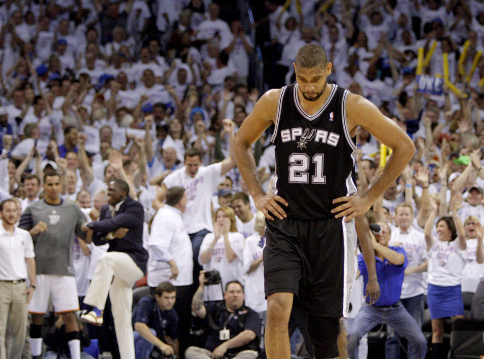 Photo - San Antonio's Tim Duncan (21) walks off the court during Game 6 of the Western Conference Finals between the Oklahoma City Thunder and the San Antonio Spurs in the NBA playoffs at the Chesapeake Energy Arena in Oklahoma City, Wednesday, June 6, 2012. Oklahoma City won 107-99. Photo by Bryan Terry, The Oklahoman