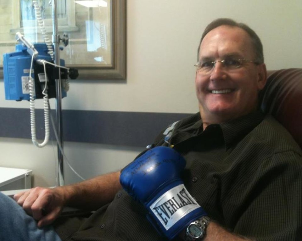 Photo -  George Knight wears one of the boxing gloves his son Trevor Knight gave him before his cancer treatments. PHOTO PROVIDED