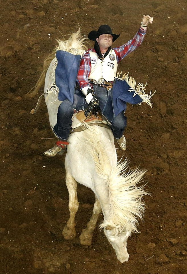 Matthew Smith rides during the bareback riding the National Circuit Finals Rodeo at the State Fair Arena in Oklahoma City, Friday, April 5, 2013. Photo by Sarah Phipps, The Oklahoman