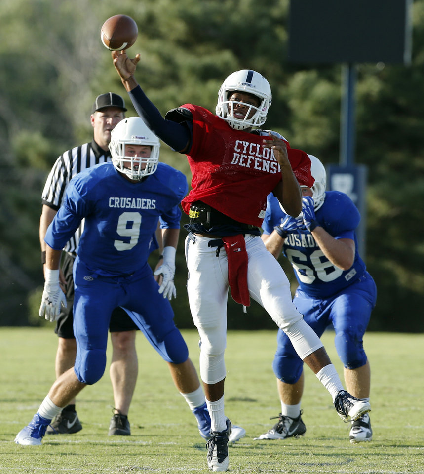 Photo - Casady's T'Quan Wallace throws against Christian Heritage Academy during at a high school football scrimmage at Casady School in Oklahoma City, Okla., on Friday, Aug. 22, 2014. Photo by Steve Sisney, The Oklahoman