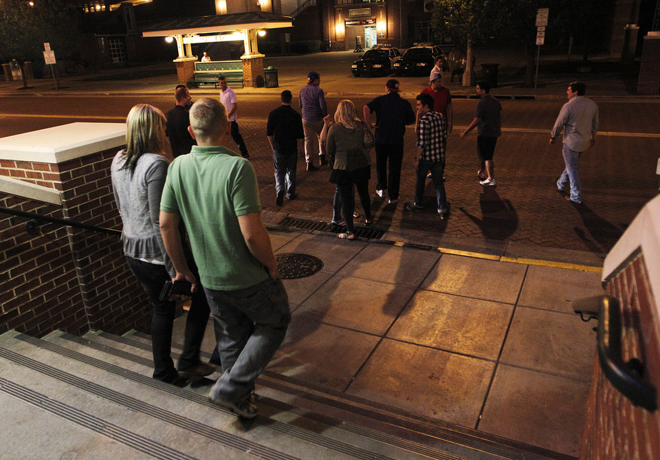 Crowds of people leave bars in the Bricktown area in Oklahoma City, Saturday, March 24, 2012.  There have been several assaults near bars in Bricktown the last eight months.  Photo by Garett Fisbeck, For The Oklahoman