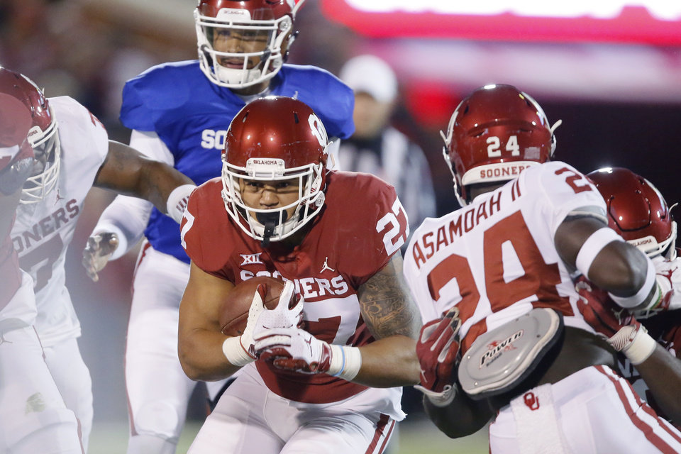 Photo - Oklahoma's Jeremiah Hall (27) carries the ball during the University of Oklahoma's (OU) spring football game at Gaylord Family-Oklahoma Memorial Stadium in Norman, Okla., Friday, April 12, 2019. Photo by Bryan Terry, The Oklahoman