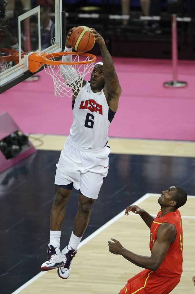 United States' LeBron James dunks against Spain's Serge Ibaka during the men's gold medal basketball game at the 2012 Summer Olympics, Sunday, Aug. 12, 2012, in London. (AP Photo/Matt Slocum)