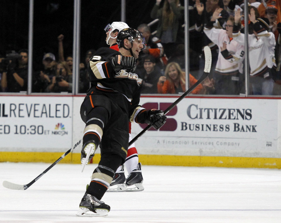 Anaheim Ducks defenseman Francois Beauchemin (23) celebrates scoring a goal against the Carolina Hurricanes during the first period of an NHL hockey game Sunday, March 2, 2014, in Anaheim, Calif. (AP Photo/Alex Gallardo)