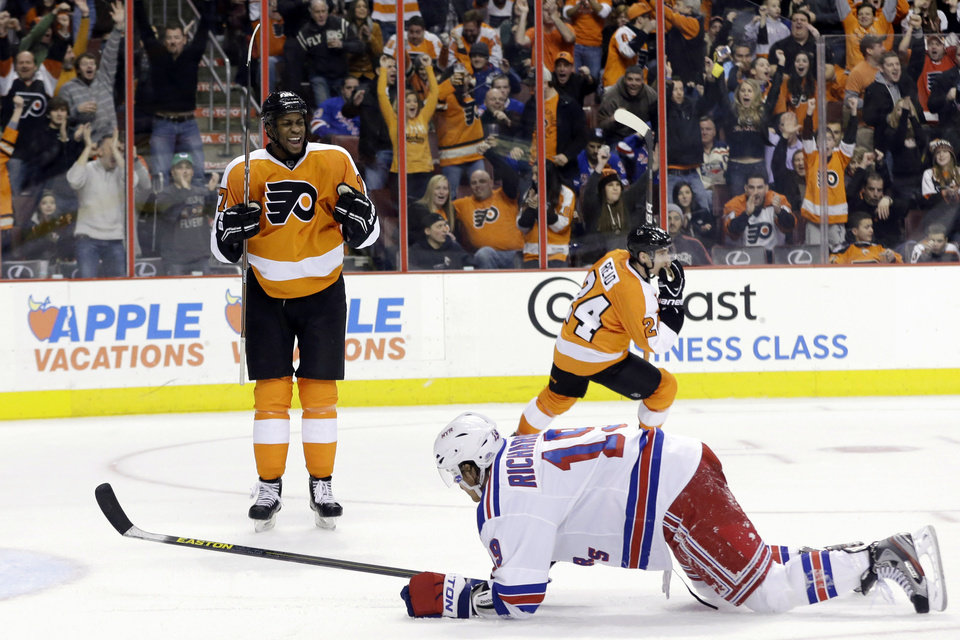 Philadelphia Flyers' Wayne Simmonds, left, and Matt Read react after Simmonds' goal as New York Rangers' Brad Richards climbs up from the ice during the second period of an NHL hockey game, Thursday, Jan. 24, 2013, in Philadelphia. (AP Photo/Matt Slocum)