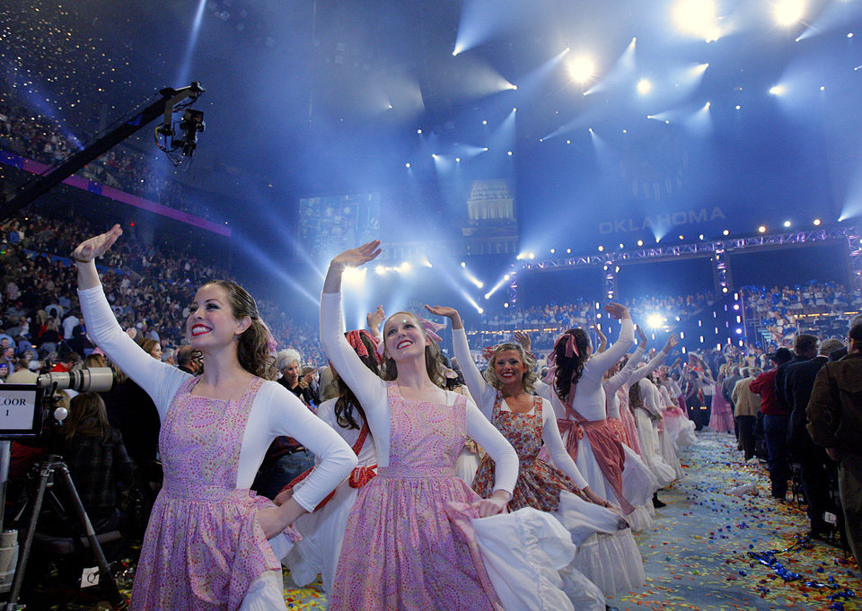 Photo - Performers wave to the crowd in the closing act during the Centennial Spectacular to celebrate the 100th birthday of the State of Oklahoma at the Ford Center on Friday, Nov. 16, 2007, in Oklahoma City, Okla. Photo By CHRIS LANDSBERGER, The Oklahoman