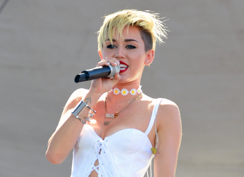 Photo - FILE - In this Sept. 21, 2013 file photo, Miley Cyrus performs at IHeartRadio Music Village in Las Vegas, Nev. Cyrus' album