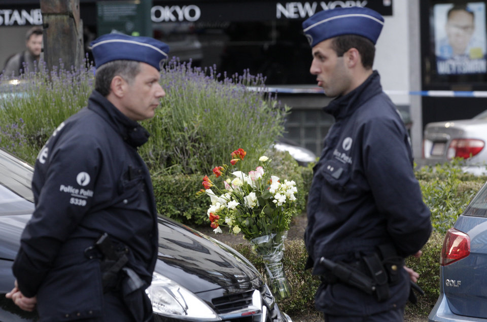 Photo - Some flowers were put close to the site of a shooting at the Jewish museum in Brussels, Saturday, May 24, 2014. Three people were killed and one seriously injured in a spree of gunfire at the Jewish Museum in Brussels on Saturday, officials said. The attack, which came on the eve of national and European Parliament elections, led officials to raise anti-terror measures.(AP Photo/Yves Logghe)