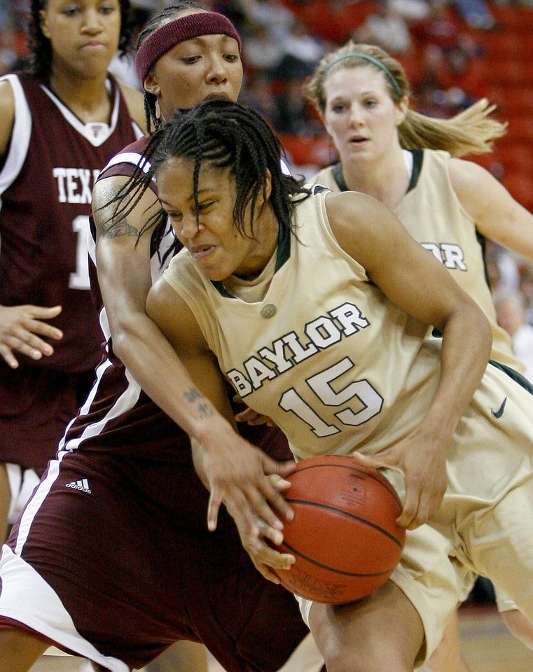 Photo - Baylor's Jhasmin Player drives past Texas A&M's Takia Starks during the championship game of the Big 12 Women's Basketball Championship between Baylor and Texas A&M at the Cox center in Oklahoma City, Sunday, March 15, 2009. PHOTO BY BRYAN TERRY, THE OKLAHOMAN