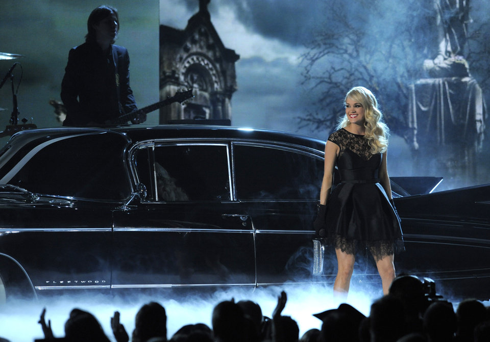 "Carrie Underwood performs ""Two Black Cadillacs"" at the 48th Annual Academy of Country Music Awards at the MGM Grand Garden Arena in Las Vegas on Sunday, April 7, 2013. (Photo by Chris Pizzello/Invision/AP) ORG XMIT: NVPM257"