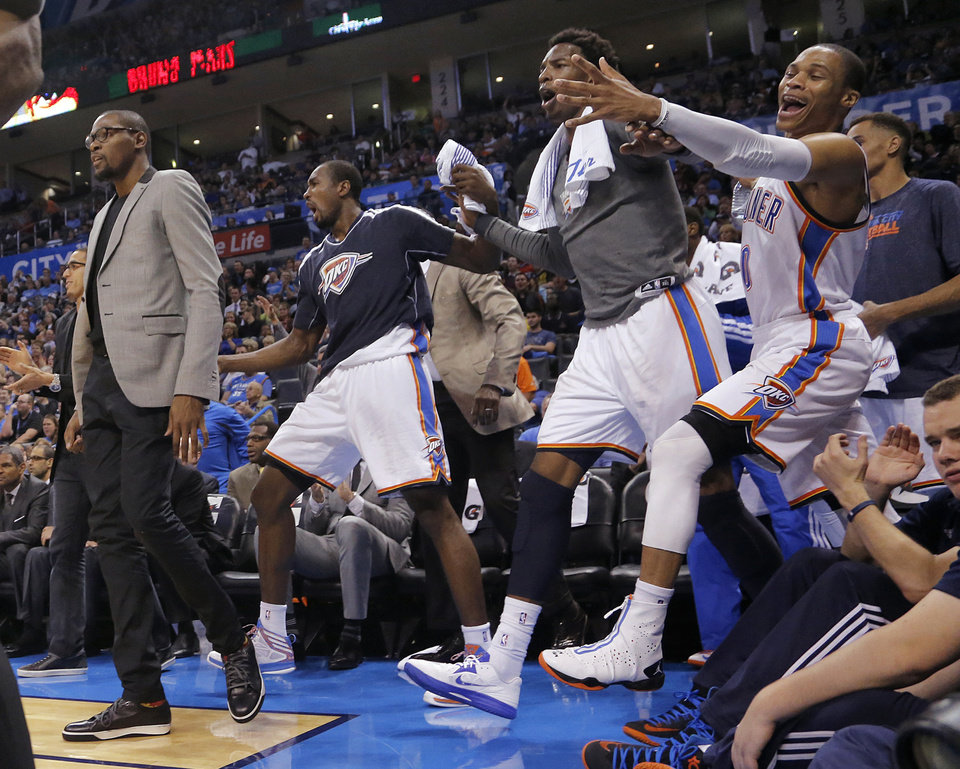 Kevin Durant and the Thunder bench react to a play during the season finally NBA basketball game between the Oklahoma City Thunder and the Milwaukee Bucks at Chesapeake Energy Arena on Wednesday, April 17, 2013, in Oklahoma City, Okla.   Photo by Chris Landsberger, The Oklahoman