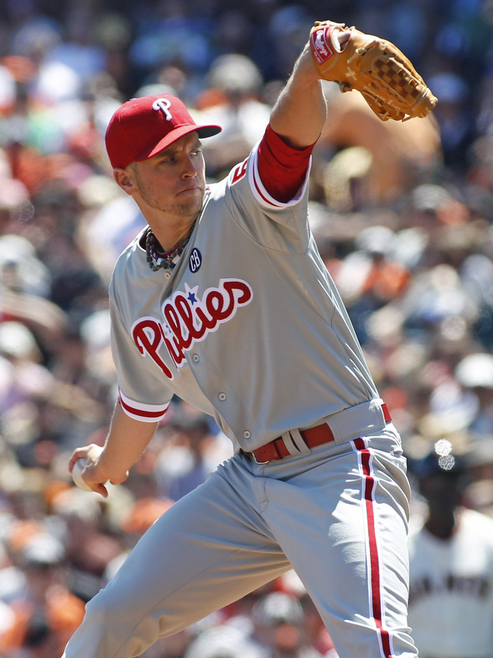 Photo - Philadelphia Phillies pitcher David Buchanan throws to the San Francisco Giants during the first inning of a baseball game, Sunday, Aug. 17, 2014 in San Francisco. (AP Photo/George Nikitin)