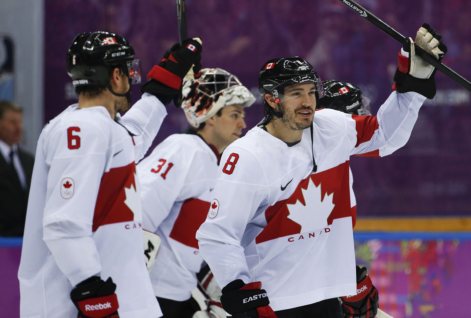 Photo - Canada defenseman Drew Doughty celebrates with teammates after Canada defeated Latvia 2-1 during a men's quarterfinal ice hockey game at the 2014 Winter Olympics, Wednesday, Feb. 19, 2014, in Sochi, Russia. (AP Photo/Julio Cortez)