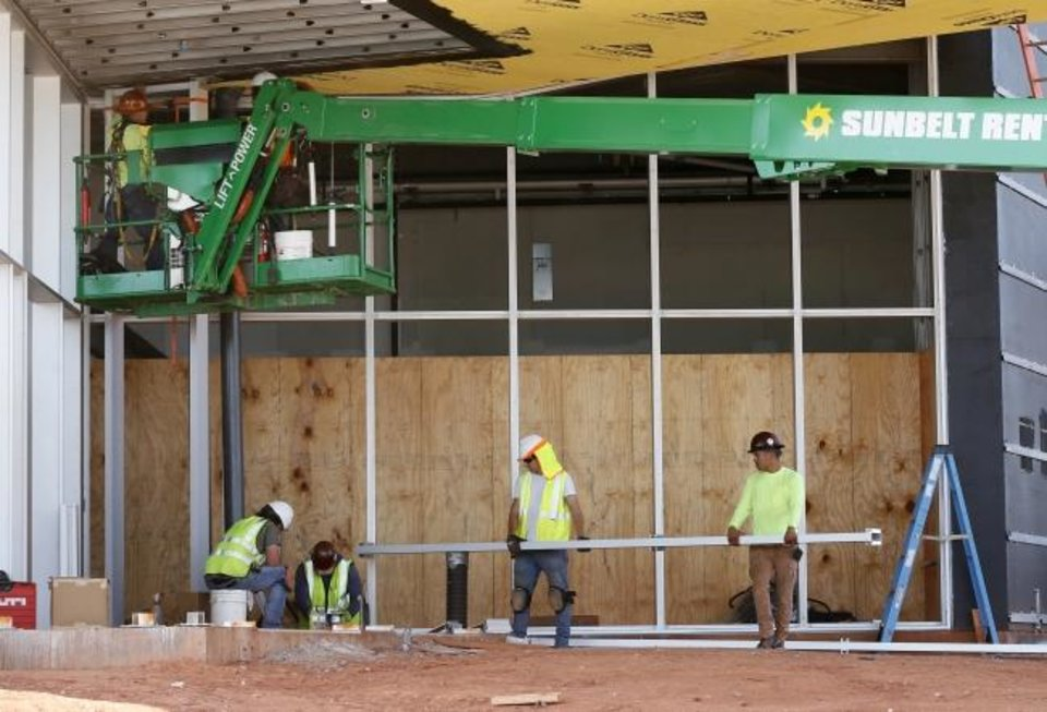 Photo -  Construction workers don't expect to be delayed by weather anymore at the new Oklahoma Contemporary Arts Center at NW 11 and Broadway. [Nate Billings/The Oklahoman]