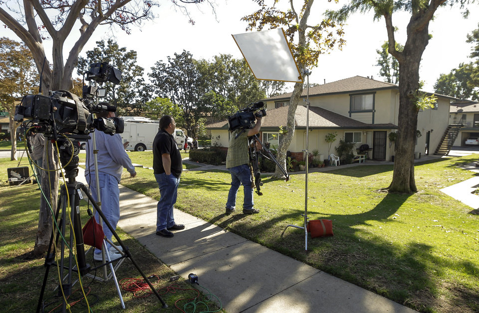 Photo -   Members of the media gather outside the home of 21-year-old Miguel Alejandro Santana Vidriales of Upland, Calif. Tuesday, Nov. 20, 2012. Vidriales is one of four Southern California men charged with plotting to kill Americans and destroy U.S. targets overseas by joining al-Qaida and the Taliban in Afghanistan, federal officials said. In one online conversation, Santana told an FBI undercover agent that he wanted to commit jihad and expressed interest in a jihadist training camp in Jalalabad, Afghanistan. (AP Photo/Damian Dovarganes)