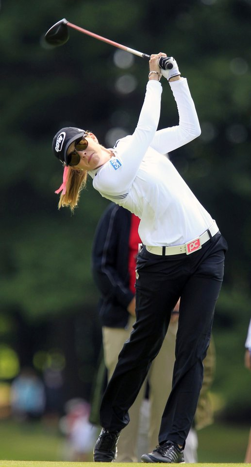 Photo - Paula Creamer tees-off on the 18th hole during the LPGA Championship at the Monroe Golf Club, Thursday, Aug. 14, 2014 in Pittsford, N.Y. (AP Photo/The Buffalo News, Harry Scull Jr)  TV OUT; MAGS OUT; MANDATORY CREDIT; BATAVIA DAILY NEWS OUT; DUNKIRK OBSERVER OUT; JAMESTOWN POST-JOURNAL OUT; LOCKPORT UNION-SUN JOURNAL OUT; NIAGARA GAZETTE OUT; OLEAN TIMES-HERALD OUT; SALAMANCA PRESS OUT; TONAWANDA NEWS OUT