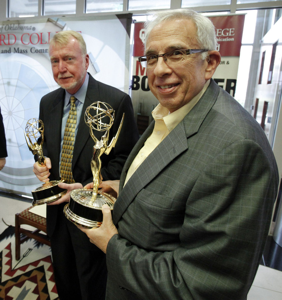 Emmy Award-winning reporter Mike Boettcher, left, and his classroom co-teacher John Schmeltzer pose with statues after Boettcher donated his Emmy awards to the Gaylord College of Journalism and Mass Communication at the University of Oklahoma on Tuesday  in Norman. Photo by Steve Sisney, The Oklahoman <strong>STEVE SISNEY</strong>