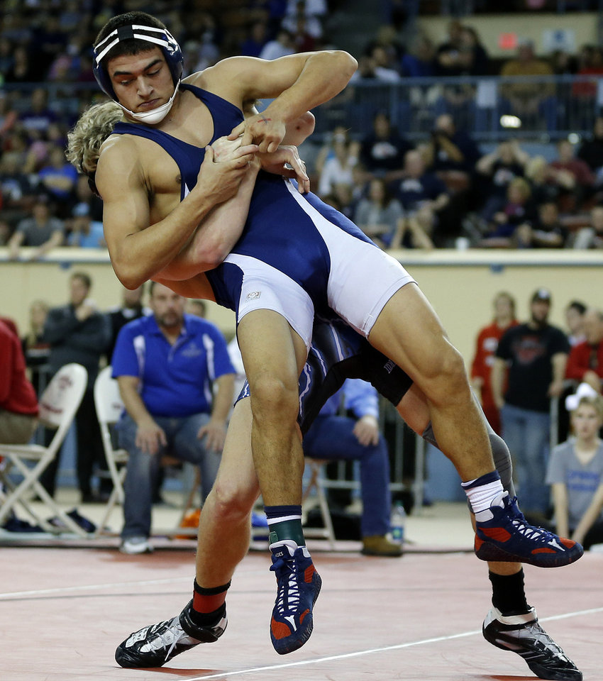 Keilan Torres of Altus wrestles Chad Draper of Deer Creek, behind, during the Class 5A 160-pound championship match during the state wrestling championships at the State Fair Arena in Oklahoma City, Saturday, Feb. 23, 2013. Photo by Bryan Terry, The Oklahoman