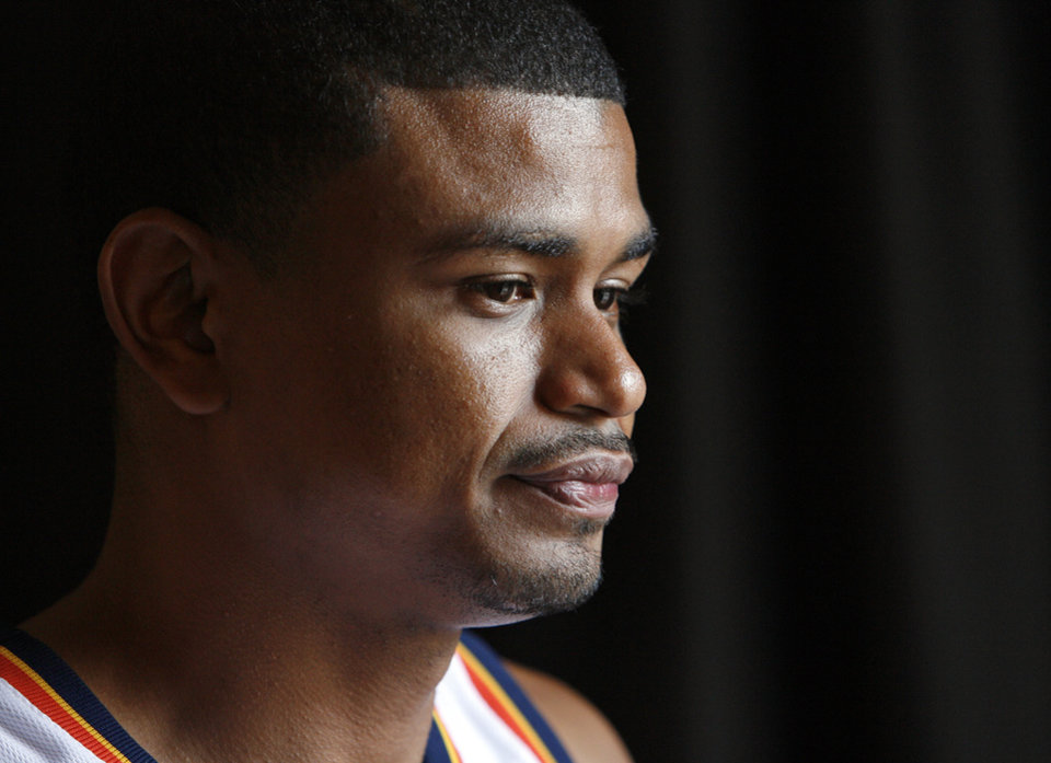 Photo - Earl Watson listens to a question during media day for the Oklahoma City Thunder NBA basketball team at the Skirvin Hilton hotel in Oklahoma City, Monday, September 29, 2008. BY NATE BILLINGS, THE OKLAHOMAN. ORG XMIT: KOD