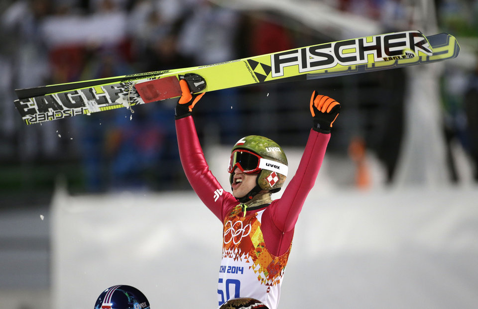 Photo - Poland's Kamil Stoch celebrates winning the gold medal during the men's normal hill ski jumping final at the 2014 Winter Olympics, Sunday, Feb. 9, 2014, in Krasnaya Polyana, Russia. (AP Photo/Gregorio Borgia)