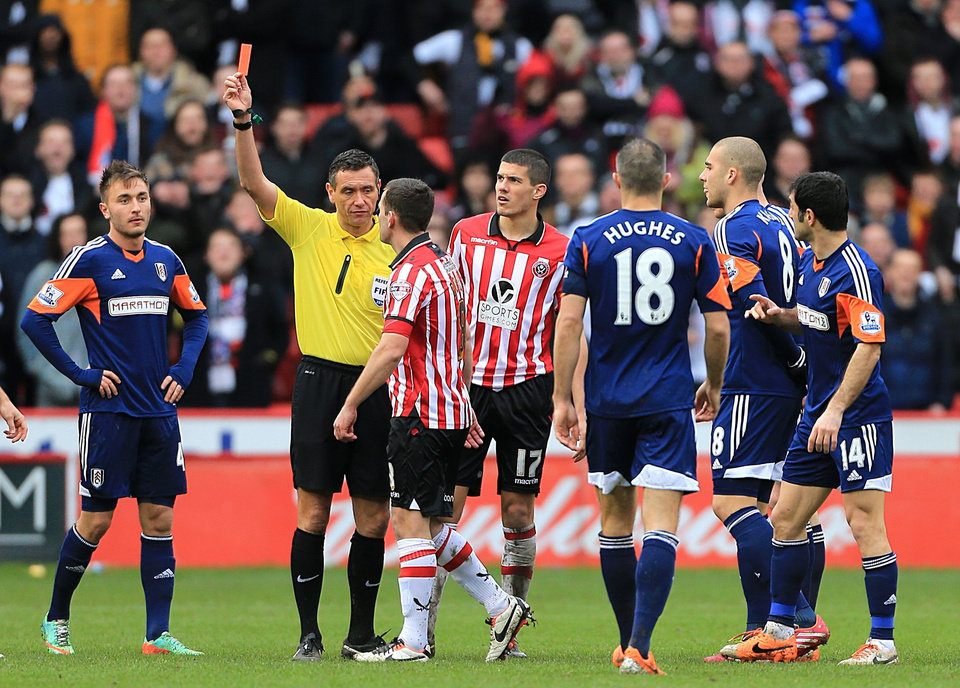 Photo - Sheffield United's Michael Doyle, left centre, is shown a red card by referee Andre Marriner following a challenge on Fulham's Chris David during their FA Cup, Fourth Round soccer match at Bramall Lane, Sheffield, England, Sunday Jan. 26, 2014. (AP Photo/PA, Nick Potts) UNITED KINGDOM OUT  NO SALES  NO ARCHIVE