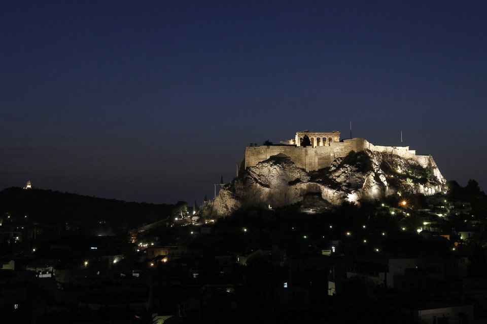 A general view of the city of Athens, with the ancient Acropolis hill, Tuesday, Nov. 1, 2011. Markets plunged Tuesday and Greece\'s beleaguered Socialist government faced collapse, a day after Prime Minister George Papandreou unexpectedly announced plans to hold a referendum on the latest international debt relief and bailout deal for his country. (AP Photo/Petros Giannakouris) ORG XMIT: ATH109
