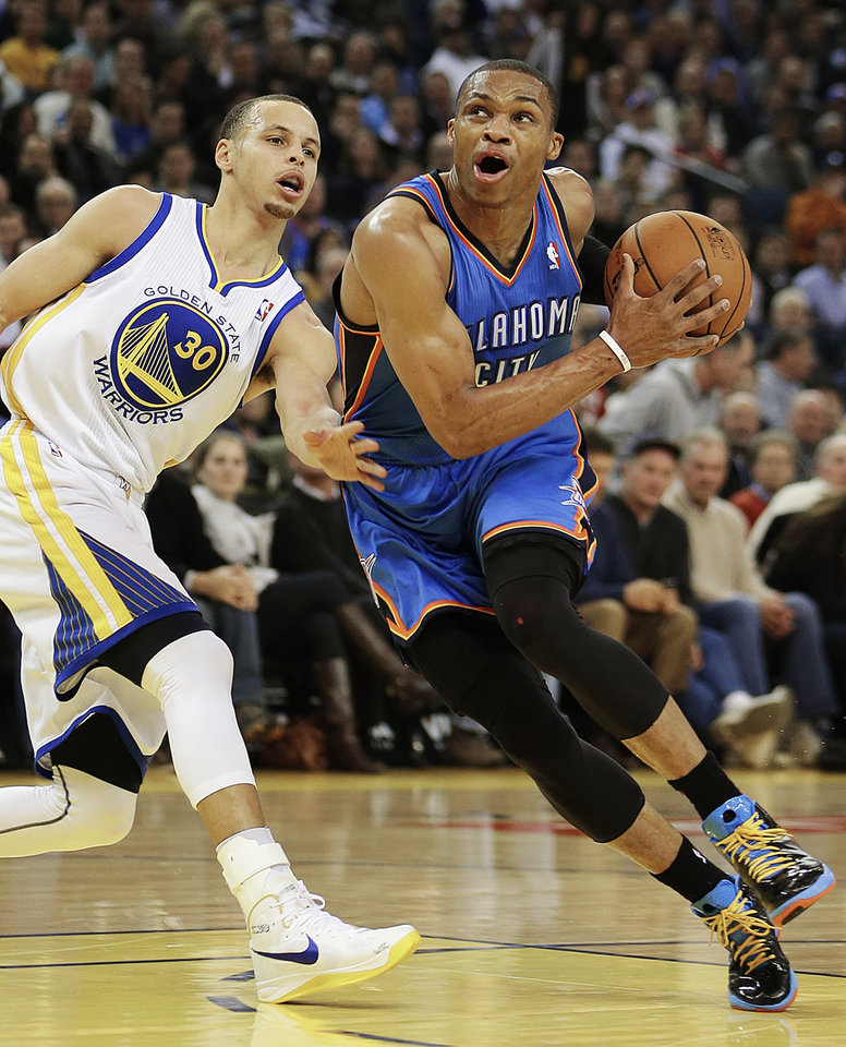 CORRECTS DATE TO JAN. 23, NOT JAN. 22 - Oklahoma City Thunder's Russell Westbrook, right, drives past Golden State Warriors' Stephen Curry (30) during the first half of an NBA basketball game, Wednesday, Jan. 23, 2013, in Oakland, Calif. (AP Photo/Ben Margot)