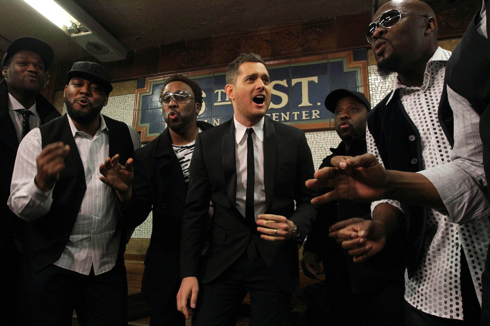In this photo provided by Transit Wireless, Canadian Crooner Michael Buble, center, and the acappella group Naturally 7 perform a song from Buble\'s just released album
