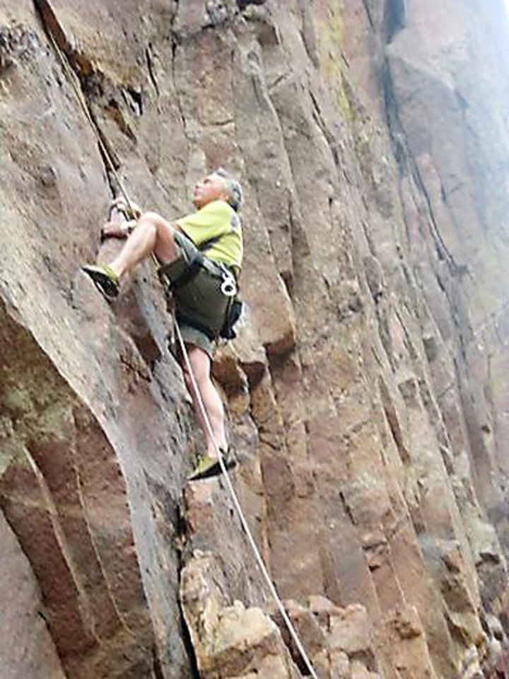 Bruce W. Day climbs huge, thin slabs of rock detached from the main face.  PHOTO PROVIDED