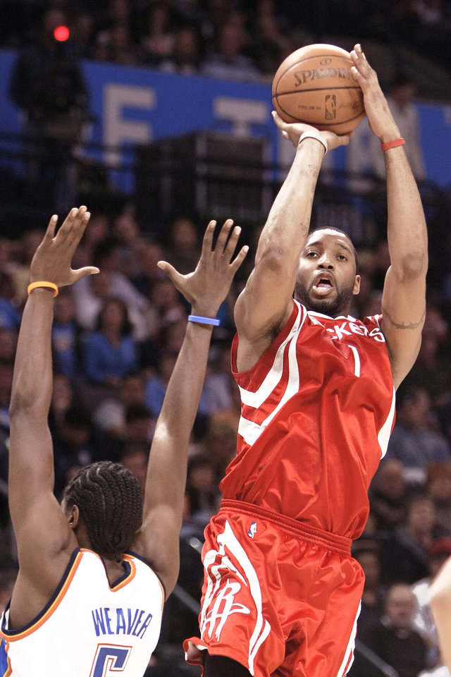 Photo - Houston's Tracy McGrady says he's ready to play, but team officials say he's not.  PHOTO BY HUGH SCOTT,  THE OKLAHOMAN