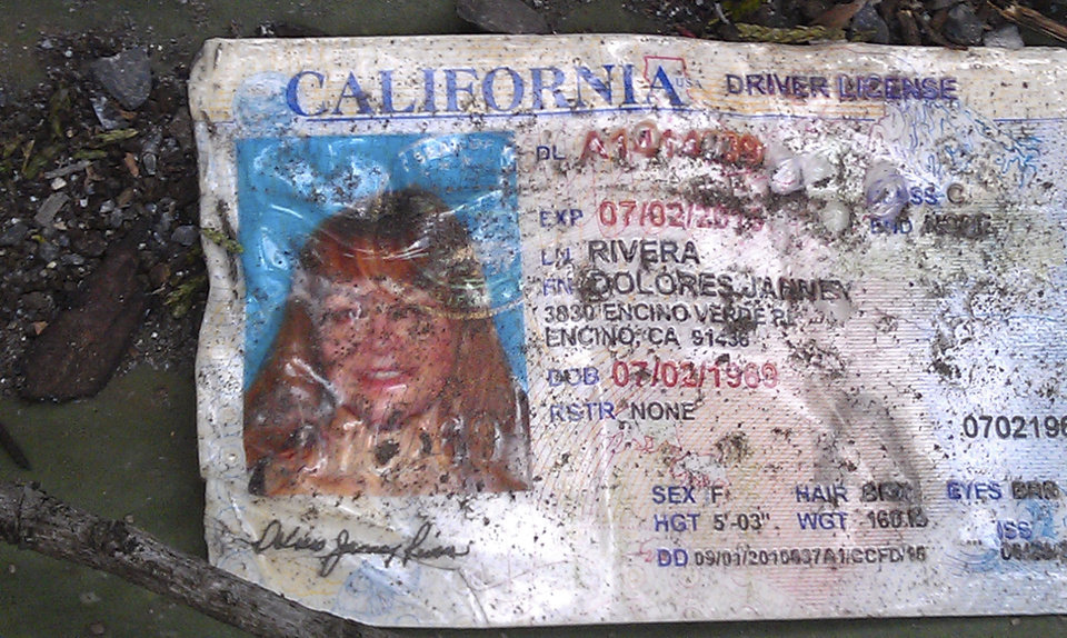 Photo - A California driver's license bearing the name of Jenni Rivera sits on the ground at the site where a plane allegedly carrying Rivera crashed near Iturbide, Mexico Sunday Dec. 9, 2012. The wreckage of a the small plane believed to be carrying Jenni Rivera, the U.S-born singer whose soulful voice and unfettered discussion of a series of personal travails made her a Mexican-American superstar, was found in northern Mexico on Sunday. Authorities said there were no survivors. (AP Photo)