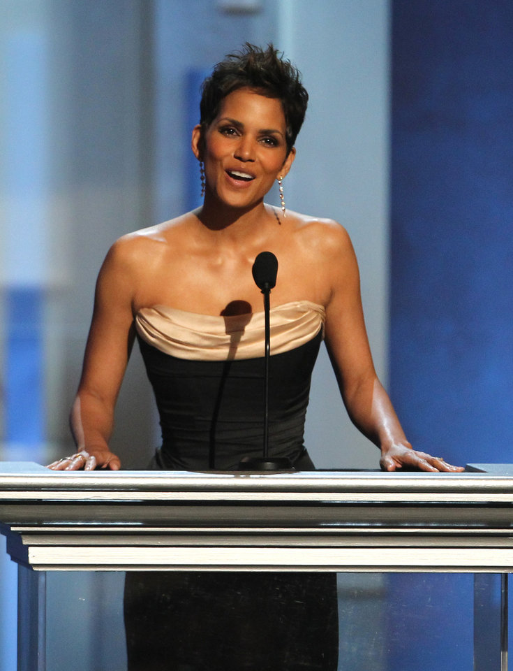 Photo - Halle Berry presents an award at the 44th Annual NAACP Image Awards at the Shrine Auditorium in Los Angeles on Friday, Feb. 1, 2013. (Photo by Matt Sayles/Invision/AP)