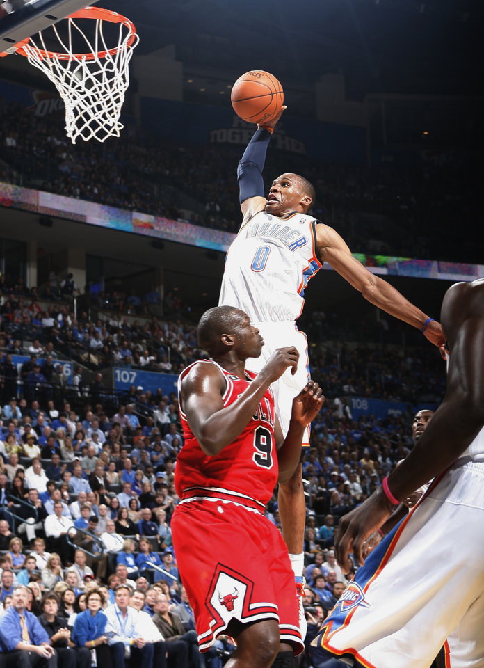 Photo - Oklahoma City's Russell Westbrook dunks the ball over Chicago's Luol Deng during the NBA basketball game between the Oklahoma City Thunder and the Chicago Bulls in the Oklahoma City Arena on Wednesday, Oct. 27, 2010. Photo by Bryan Terry, The Oklahoman