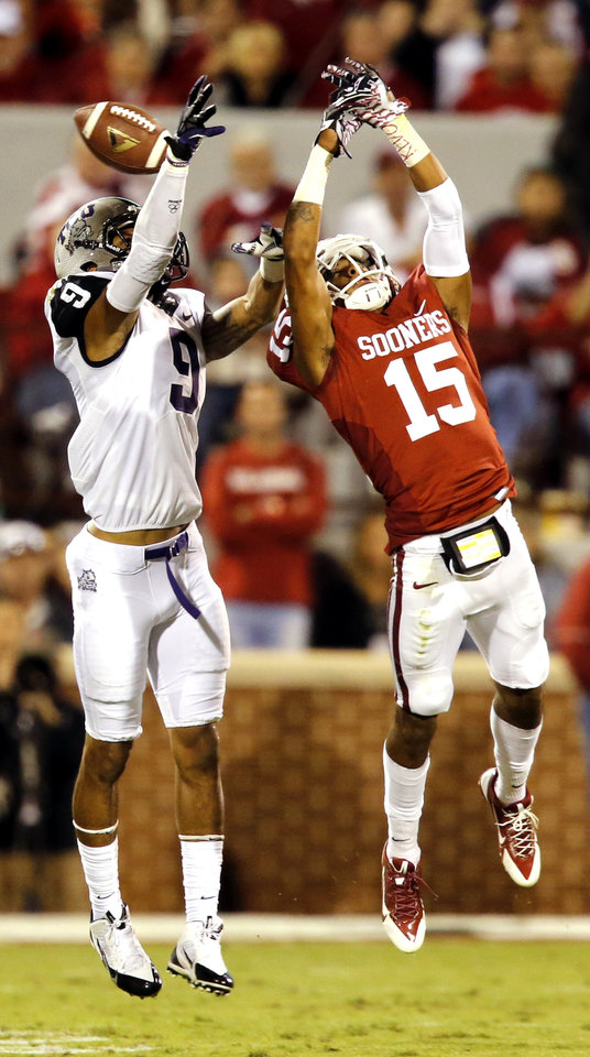 Oklahoma's Zack Sanchez, right, breaks up a pass intended for TCU's Josh Doctson during a 2013 game.                     PHOTO BY STEVE SISNEY, THE OKLAHOMAN ARCHIVES