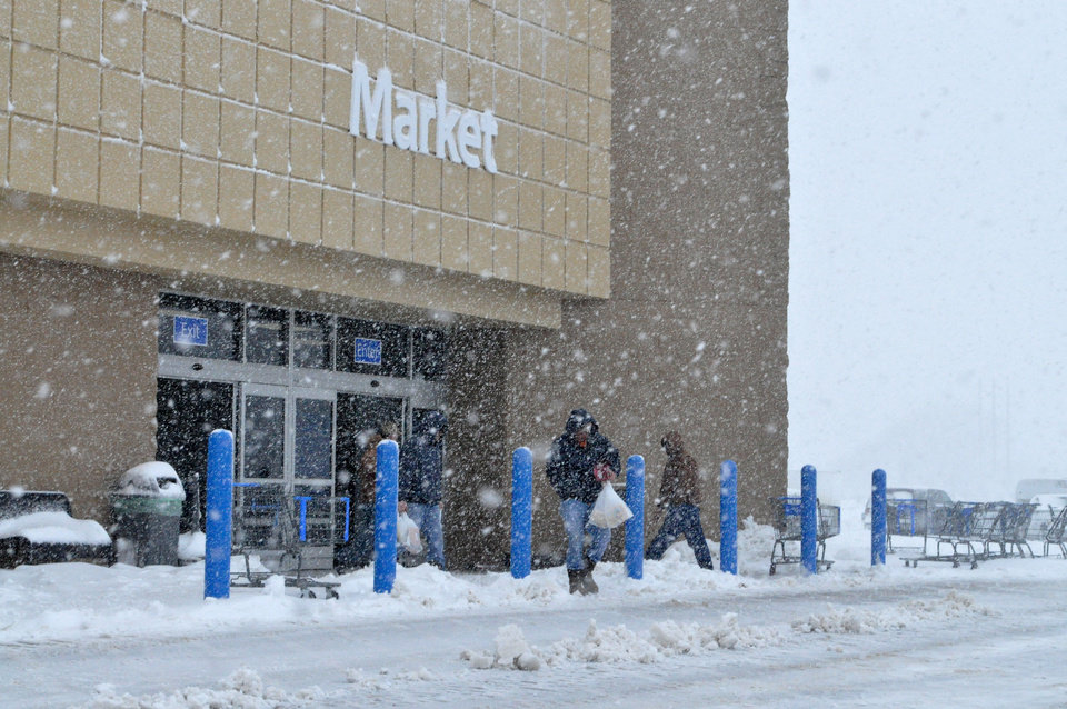 Photo - People braving the blizzard to get some items at Walmart in Woodward, Oklahoma Monday, February 25, 2013, which was one of the few stores still open despite the harsh winter weather.  Photo by Rowynn Ricks ,Woodward News