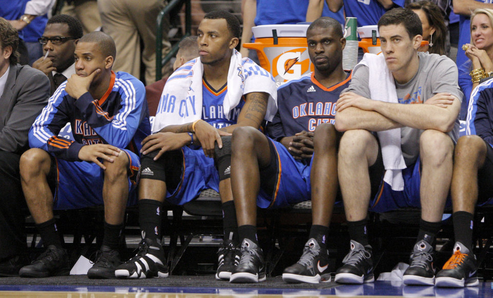 Oklahoma City's Eric Maynor, left, Daequan Cook, Nazr Mohammed, and Nick Collison sit on the bench during game 1 of the Western Conference Finals in the NBA basketball playoffs between the Dallas Mavericks and the Oklahoma City Thunder at American Airlines Center in Dallas, Tuesday, May 17, 2011. Photo by Bryan Terry, The Oklahoman ORG XMIT: KOD