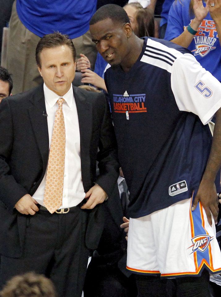 Kendrick Perkins talks with Thunder Head Coach Scott Brooks during the second half of game 7 of the NBA basketball Western Conference semifinals between the Memphis Grizzlies and the Oklahoma City Thunder at the OKC Arena in Oklahoma City, Sunday, May 15, 2011. The Thunder beat the Grizzlies 105-90 to advance to the Western Conference finals against Dallas. Photo by John Clanton, The Oklahoman