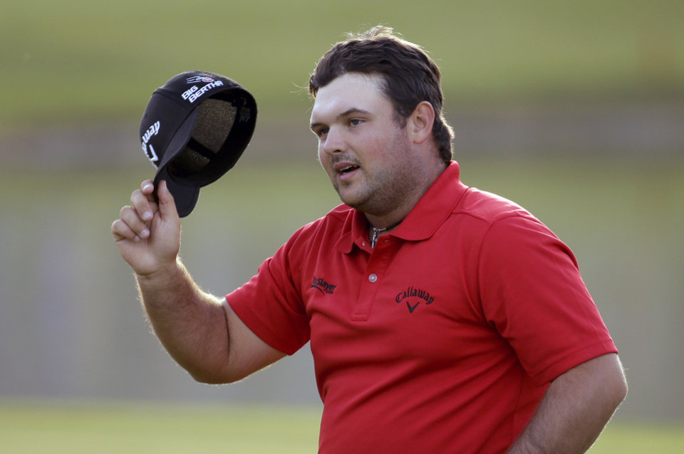 Photo - Patrick Reed waves after winning the Humana Challenge golf tournament on the Palmer Private course at PGA West, Sunday, Jan. 19, 2014 in La Quinta, Calif. (AP Photo/Chris Carlson)