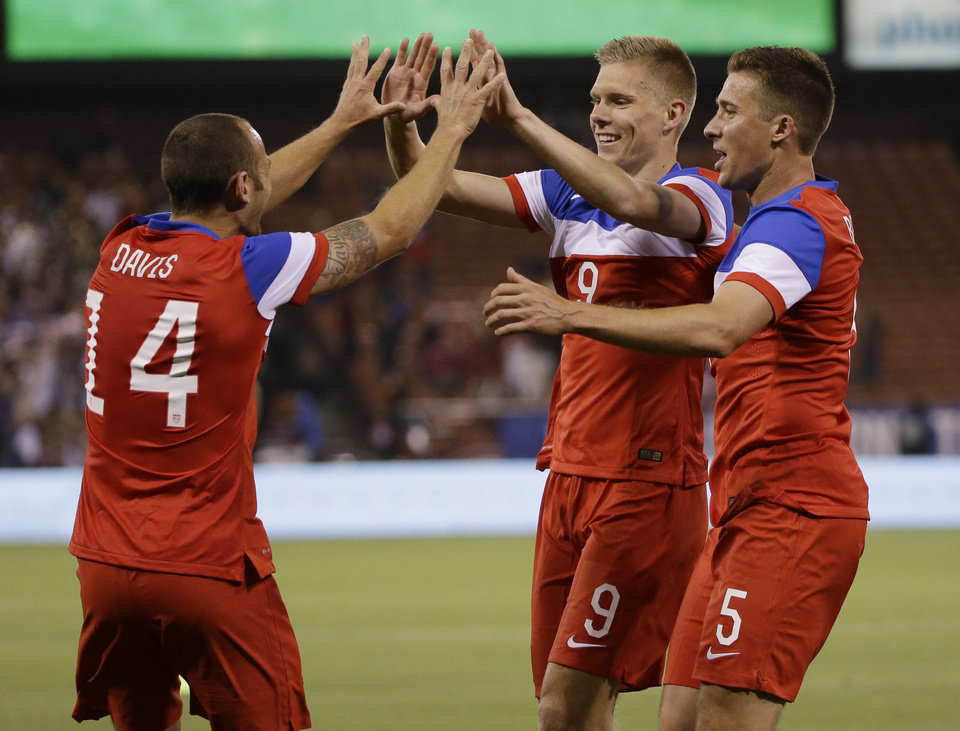 Photo - United States' Aron Johannsson (9) celebrates his goal with teammate Matt Besler, right, and Brad Davis (14)  during the second half of an international friendly soccer match against Azerbaijan on Tuesday, May 27, 2014, in San Francisco. United States won 2-0. (AP Photo/Marcio Jose Sanchez)
