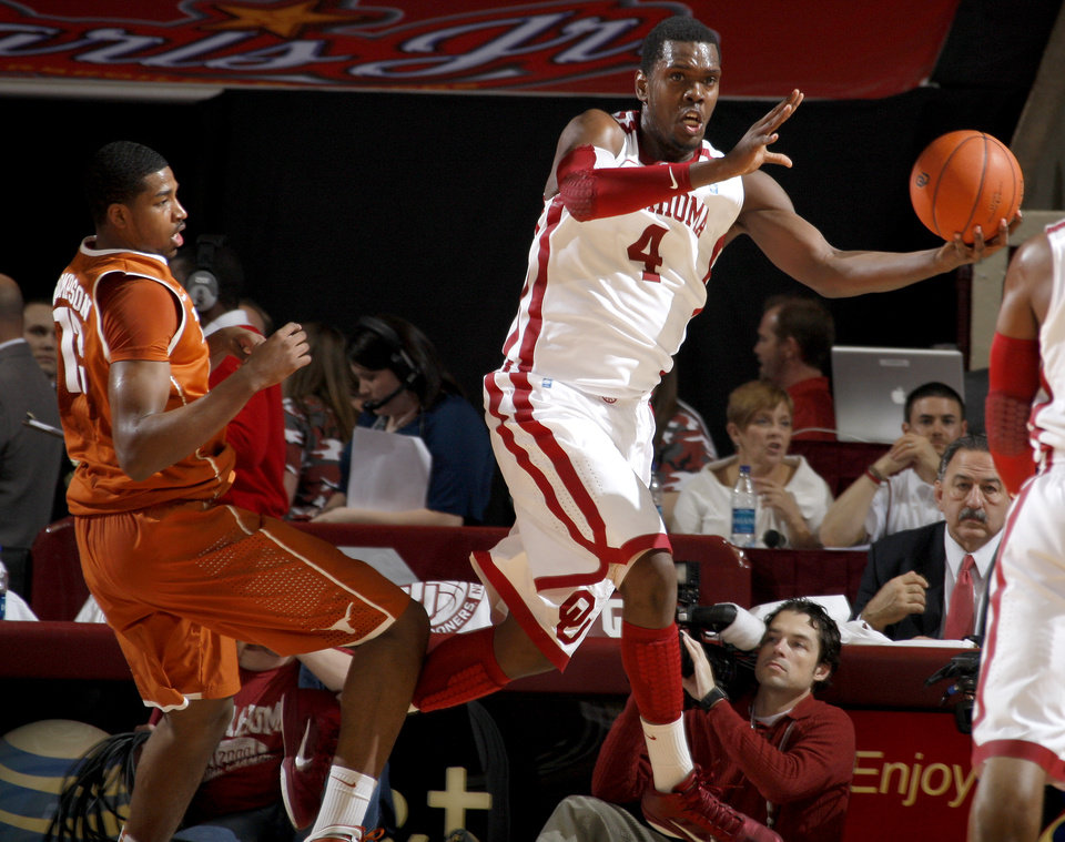 Photo - Oklahoma's Andrew Fitzgerald (4) grabs the ball in front of Texas' Tristan Thompson during the NCAA college basketball game between the University of Oklahoma Sooners and Texas Longhorns at Lloyd Noble Center in Norman, Okla., Wednesday, Feb. 9, 2011. Photo by Bryan Terry, The Oklahoman
