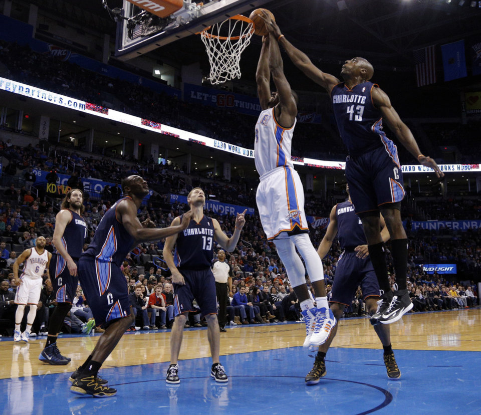 Photo - Oklahoma City's Serge Ibaka (9) goes up for a basket as Charlotte's Anthony Tolliver (43) fouls him during the NBA basketball game between the Oklahoma City Thunder and the Charlotte Bobcats at the Chesapeake Energy Arena, Sunday, March 2, 2014. Photo by Sarah Phipps, The Oklahoman