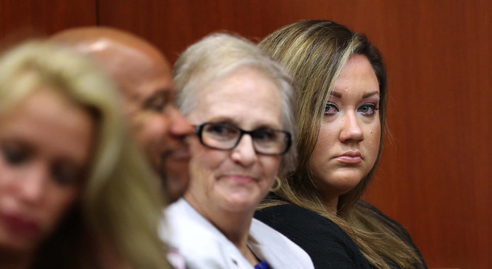 Photo - Shelly Zimmerman, right, wife of George Zimmerman, watches proceedings in his trial in Seminole circuit court in Sanford, Fla., Wednesday, June 12, 2013. George Zimmerman has been charged with second-degree murder for the 2012 shooting death of Trayvon Martin.(AP Photo/Orlando Sentinel, Joe Burbank, Pool)