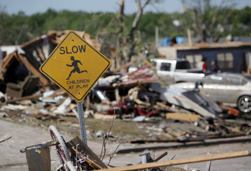A sign stands among piled debris in Woodward, Okla., Monday, April 16, 2012. A tornado struck the town early Sunday morning. Photo by Nate Billings, The Oklahoman